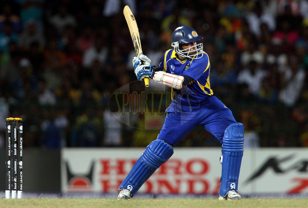 Sri Lankan batsman Tillakaratne Dilshan plays a shot against England during the ICC Cricket World Cup - 4th Quarter-Final Played at R Premadasa Stadium, Colombo