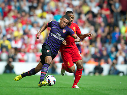 LIVERPOOL, ENGLAND - Sunday September 2, 2012: Liverpool's Raheem Sterling in action against Arsenal's Alex Oxlade-Chamberlain during the Premiership match at Anfield. (Pic by David Rawcliffe/Propaganda)