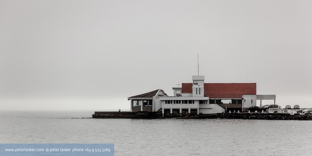 Tamaki Yacht Club on a foggy morning. Tamaki Drive, Auckland, New Zealand.