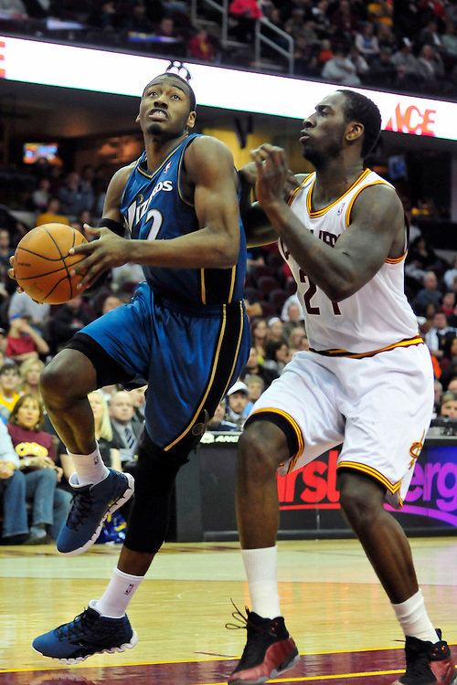 Feb. 13, 2011; Cleveland, OH, USA; Washington Wizards point guard John Wall (2) shoots over Cleveland Cavaliers power forward J.J. Hickson (21) during the fourth quarter at Quicken Loans Arena. The Wizards beat the Cavaliers 107-93 for their first win on the road this season. Mandatory Credit: Jason Miller-US PRESSWIRE
