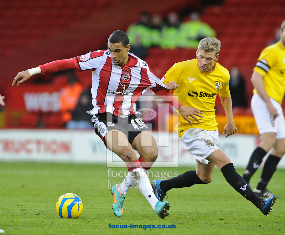 Picture by Richard Land/Focus Images Ltd +44 7713 507003.01/12/2012.Nick Blackman of Sheffield Utd and Kingsley James of Port Vale during the The FA Cup match at Bramall Lane, Sheffield.