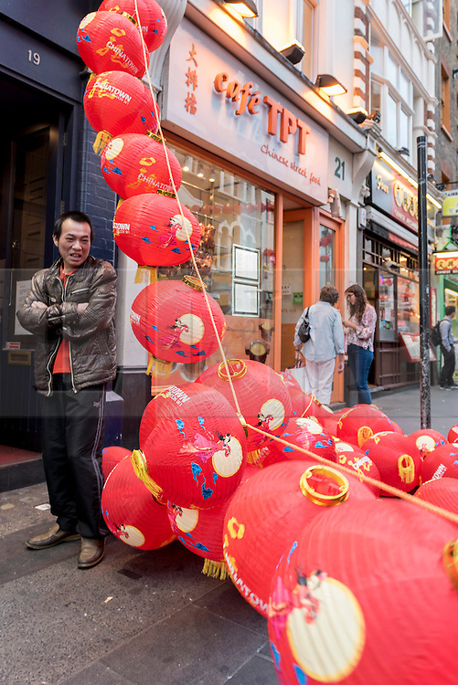© Licensed to London News Pictures. 09/09/2016. London, UK. Colourful, traditional paper lanterns are hung in Chinatown on the eve of the Mid-Autumn Festival.  Held annually on the 15th day of the 8th month in the lunar calendar, it is the second most important holiday after Chinese New Year and celebrates harvest and the bright harvest moon.  For many Chinese, the moon symbolises prosperity, peace and reunion. Photo credit : Stephen Chung/LNP