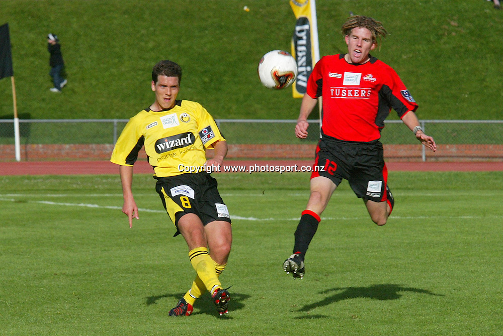 Wellington's Tim Butterfield holds off Canterbury's Jeremy Brockie during the 2 all draw on Newtown Park, Sunday afternoon. Soccer NZFC Round 1 17 October 2004.<br /> Photo: Marty Melville/Photosport