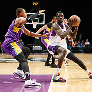 Reno Bighorns Guard BRANDON AUSTIN (4) works against South Bay Lakers Guard DEMARCUS HOLLAND (7) during the Western Conference Semi-Final NBA G-League Basketball game between the Reno Bighorns and the South Bay Lakers at the Reno Events Center in Reno, Nevada.