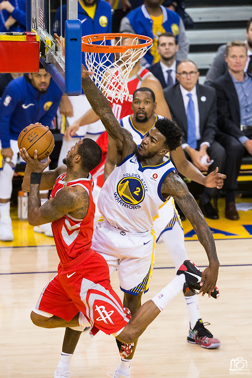 Golden State Warriors center Jordan Bell (2) attempts to block a shot by Houston Rockets forward Trevor Ariza (1) during Game 6 of the Western Conference Finals at Oracle Arena in Oakland, Calif., on May 26, 2018. (Stan Olszewski/Special to S.F. Examiner)