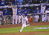 Oct 27, 2015; Kansas City, MO, USA; Kansas City Royals left fielder Alex Gordon (4) reacts after hitting a solo home run to tie the game against the New York Mets in the 9th inning in game one of the 2015 World Series at Kauffman Stadium. Mandatory Credit: Peter G. Aiken-USA TODAY Sports