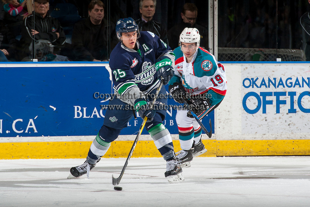 KELOWNA, CANADA - FEBRUARY 13: Dillon Dube #19 of the Kelowna Rockets back checks Ethan Bear #25 of the Seattle Thunderbirds on February 13, 2017 at Prospera Place in Kelowna, British Columbia, Canada.  (Photo by Marissa Baecker/Shoot the Breeze)  *** Local Caption ***