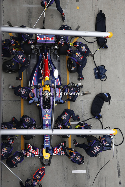 20.04.2014. SHanghai, China.  Motorsports: FIA Formula One World Championship 2014, Grand Prix of China, 1 Sebastian Vettel (GER, Infiniti Red Bull Racing) <br />  in the pits for a tyre change