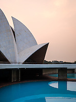 "NEW DELHI, INDIA - CIRCA OCTOBER 2016: The Lotus Temple in Delhi, also known as the  Bahai House of Worship. This is a popular tourist attraction in Delhi. The building is composed of 27 free-standing marble-clad ""petals"" arranged in clusters of three to form nine sides, with nine doors opening."