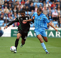 Photo: Ed Godden.<br /> Coventry City v Plymouth Argyle. Coca Cola Championship. 30/09/2006. Coventry's Marcus Hall (L) challenges Reuben Reid.