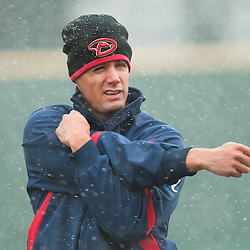 Pitcher Joe Martinez stretches in the snow back in 2012. Photo by David Calvert/Reno Aces