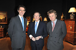 Left to right, JAMES PEILL, The 29th Knight of Glin DESMOND FITZGERALD and JAMES FENNELL at a party to celebrate the publication of The irish Country House written by The Knight of Glin and James Peill with photographs by James Fennell, held at Christie's, King Street, London on 24th January 2011.