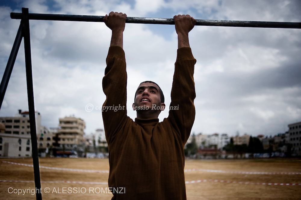 GAZA CITY : A Palestinian candidates perform a physical test at a Hamas police recruitment center in Gaza City on February 3, 2010. Thousands of young men arrived to be tested by the Islamist movement Hamas' security forces for a chance to enter the police academy.
