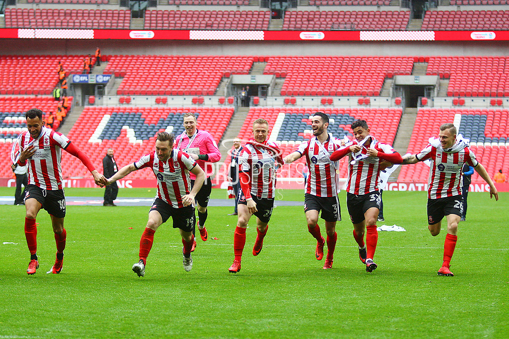 Lincoln City players celebrate during the EFL Trophy Final match between Lincoln City and Shrewsbury Town at Wembley Stadium, London, England on 8 April 2018. Picture by John Potts.