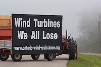 Ontario farmer putting a roadside sign up in support of Ontario Wind Resistance.