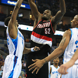 02 February 2009:  Portland Trailblazers center Greg Oden (52) grabs a rebound between Hornets defenders Rasual Butler (45) and David West (30)during a 97-89 loss by the New Orleans Hornets to the Portland Trail Blazers at the New Orleans Arena in New Orleans, LA.