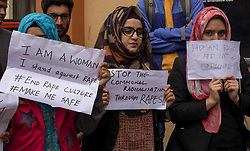 April 16, 2018 - Srinagar, Kashmir, India - Kashmiri student protesters hold, placards during a protest against the rape and murder of a eight year old Muslim girl in Srinagar, the summer capital of Indian administered Kashmir. Students across the valley took to the streets and also hold silent protest inside various educational institutes in Srinagar, the summer capital of Indian controlled Kashmir against the rape and murder of a minor Muslim girl of a minor community of Gujar and Bakarwal from disputed Himalayan region's Kathua area. (Credit Image: © Masrat Zahra/SOPA Images via ZUMA Wire)