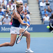 2016 U.S. Open - Day 6  Simona Halep of Romania in action against Timea Babos of Hungary in the Women's Singles round three match on Arthur Ashe Stadium on day six of the 2016 US Open Tennis Tournament at the USTA Billie Jean King National Tennis Center on September 3, 2016 in Flushing, Queens, New York City.  (Photo by Tim Clayton/Corbis via Getty Images)