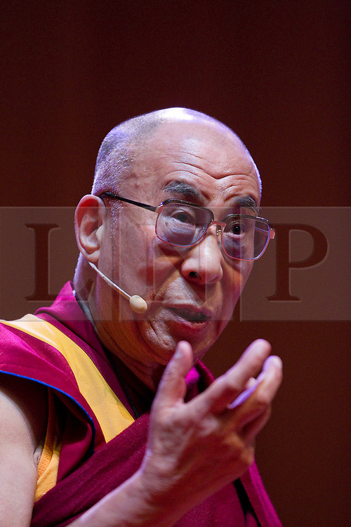© Licensed to London News Pictures. 16/06/2012. Manchester , UK . The Dalai Lama at the Manchester Arena , Greater Manchester , at the Stand Up and Be the Change youth event . The Dalai Lama is on a 10 day tour of the UK . Photo credit : Joel Goodman/LNP