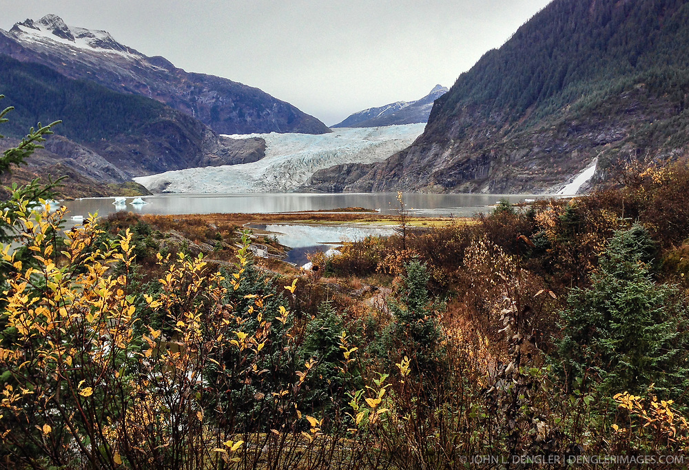 The Mendenhall Glacier runs roughly 12 miles, originating in the Juneau Icefield, near Juneau, Alaska. This photo of the glacier was taken on the Trail of Time. The glacier is located 12 miles from downtown Juneau.