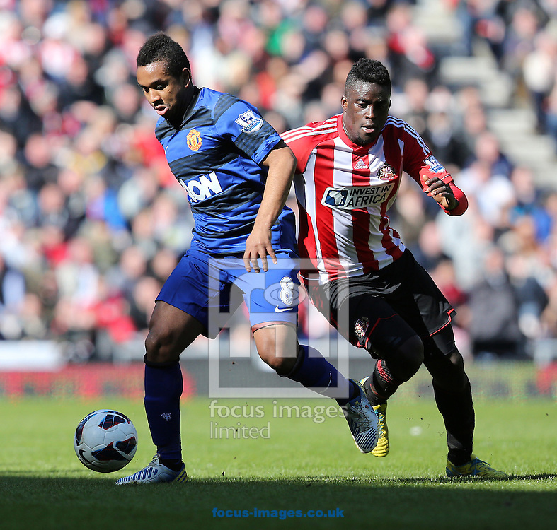 Picture by Paul Gaythorpe/Focus Images Ltd +447771 871632.30/03/2013.Anderson of Manchester United and Stephane Sessegnon of Sunderland during the Barclays Premier League match at the Stadium Of Light, Sunderland.