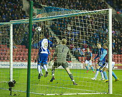 WIGAN, ENGLAND - Tuesday, March 16, 2010: Wigan Athletic's Chris Kirkland cannot prevent team-mate James McCarthy scoring an own goal during the Premiership match against Aston Villa at the DW Stadium. (Photo by David Rawcliffe/Propaganda)