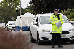 © Licensed to London News Pictures. 01/07/2017. GRAYS, Essex, UK.  Police cordon at Blackshots Lane in Grays, Essex. A man has died and three others have life threatening injuries following a street fight in Blackshots Lane, Grays, Essex last night.  Photo credit: Vickie Flores/LNP