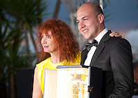 Sabine Azema with  Cesar Augusto Acevedo, winner of the Camera d'Or for La Tierra y la Sombra at the Palm D'Or award winners photo call at the 68th Cannes Film Festival Sunday May 24th 2015, Cannes, France.