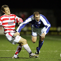 Hamilton v St Johnstone..29.12.04<br />Paul Sheerin is brought down by Scott Tunbridge.<br /><br />Picture by Graeme Hart.<br />Copyright Perthshire Picture Agency<br />Tel: 01738 623350  Mobile: 07990 594431