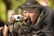 A Civil war re-enactor in period mourning costume takes a photo with a digital camera during a service at Elmwood Cemetery to mark Confederate Memorial Day May 2, 2015 in Columbia, SC. Confederate Memorial Day is a official state holiday in South Carolina and honors those that served during the Civil War.