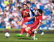 Brighton player Jamie Murphy evades a challenge from Blackburn Rovers player Danny Guthrie during the Sky Bet Championship match between Brighton and Hove Albion and Blackburn Rovers at the American Express Community Stadium, Brighton and Hove, England on 22 August 2015. Photo by Bennett Dean.