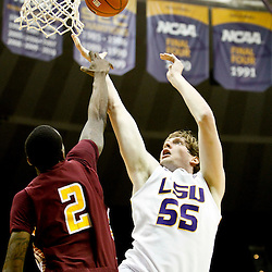 Jan 5, 2013; Baton Rouge, LA, USA; Bethune-Cookman Wildcats forward Alex Smith (2) blocks a shot by LSU Tigers center Andrew Del Piero (55) during the second half of a game at the Pete Maravich Assembly Center. LSU defeated Bethune-Cookman 79-63. Mandatory Credit: Derick E. Hingle-USA TODAY Sports