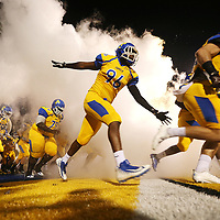 Tupelo's Kerry Mckenzie runs out onto the field with the team before the start of Friday night's game against Oxford.
