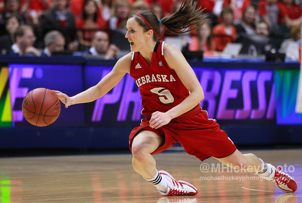 March 04, 2012; Indianapolis, IN, USA; Nebraska Cornhuskers guard Kaitlyn Burke (5) tries to maintain control of the ball against the Purdue Boilermakers during the finals of the 2012 Big Ten Tournament at Bankers Life Fieldhouse.  Mandatory credit: Michael Hickey-US PRESSWIRE