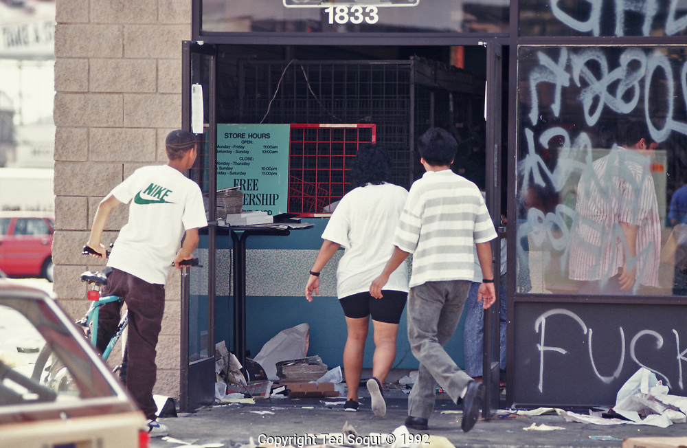 Looters enter a store in South Central Los Angeles.