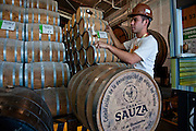 A tour guide pours a sample of aged tequila from a barrel at the Casa Sauza distillery in Tequila.