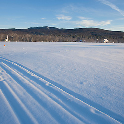 Ski tracks in a field in Wonalancet, New Hampshire in the White Mountains.  The Sandwich Range is in the distance.