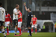 Fulham defender, Dan Burn (33), yellow card during the Sky Bet Championship match between Fulham and Charlton Athletic at Craven Cottage, London, England on 20 February 2016. Photo by Matthew Redman.
