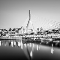 Boston Zakim Bunker Hill Bridge at night black and white photo. The Leonard P. Zakim Bunker Hill Memorial Bridge is a cable bridge that spans the Charles River in Boston, Massachusetts in the Eastern United States of America.
