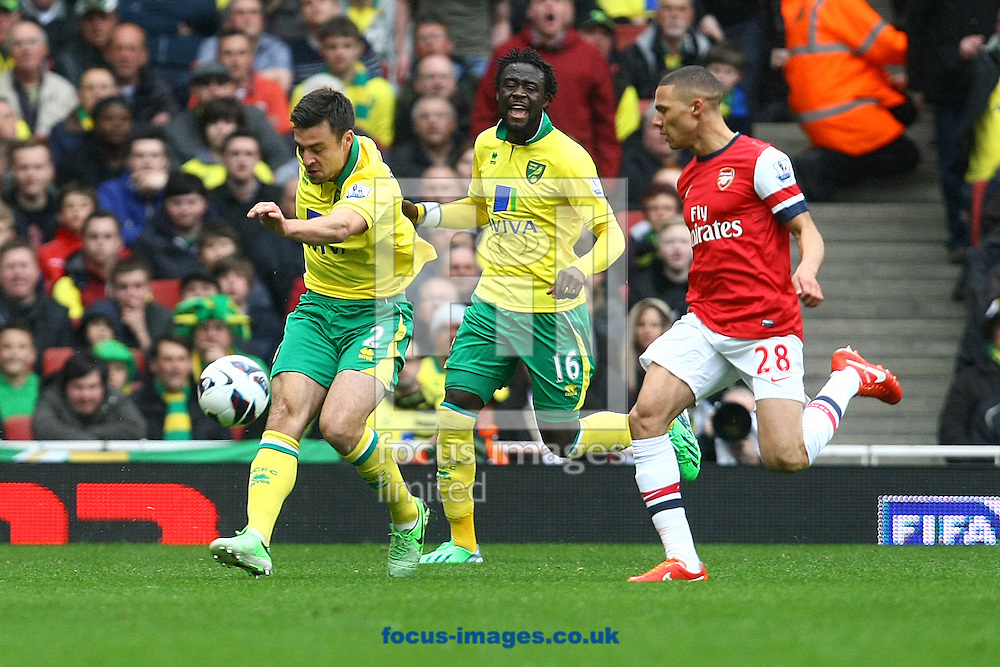 Picture by Paul Chesterton/Focus Images Ltd +44 7904 640267.13/04/2013.Russell Martin of Norwich and Kieran Gibbs of Arsenal in action during the Barclays Premier League match at the Emirates Stadium, London.