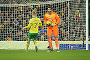 Derby County goalkeeper Scott Carson (1) finds it funny that he just beat Norwich City forward Steven Naismith to the ball during  the EFL Sky Bet Championship match between Norwich City and Derby County at Carrow Road, Norwich, England on 2 January 2017. Photo by Nigel Cole.