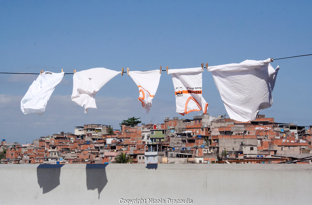 School shirts on Clothesline, Complexo do Alemão 2006. <br />