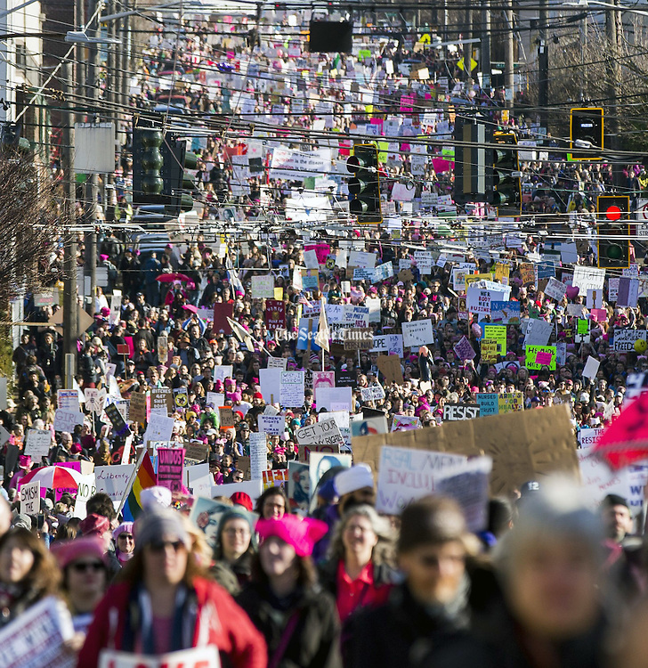 The Womxn's March on Seattle flows down South Jackson Street on Saturday. Organizers originally had predicted a crowd of up to 50,000. The number of participants was at least more than double that; organizers are saying 200,000 marched. (Bettina Hansen / The Seattle Times)