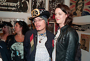 ADAM ANT; WITH HIS X WIFE LORRAINE GODDARD, Toby Mott exhibition. Haunch of Venison. Burlington Gdns. London. 23 September 2010. -DO NOT ARCHIVE-© Copyright Photograph by Dafydd Jones. 248 Clapham Rd. London SW9 0PZ. Tel 0207 820 0771. www.dafjones.com.