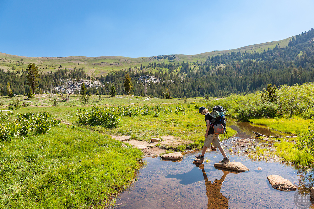 """Hiking the Pacific Crest Trail 1"" - Photograph of a teenager hiking with a backpack on the Pacific Crest Trail at Lower Castle Creek in Tahoe."