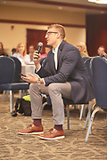 Michael Coe asks the Marketing Advisory Board a question during the Q&A session.
