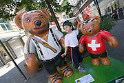 Teddy-Summer2005 in Zurich, Switzerland. .Wilhelm Tell (l.) and son with apple on his head..After the success of the summer events in recent years - the cows in 1998 and benches in 2001, the city of Zurich is continuing the tradition this year with «Teddy Summer 2005». From May 23rd until September 18th around 630 teddies - small, large, in groups, sitting or standing and creatively decorated by various artists will make their mark on the city of Zurich and the airport Zurich-Kloten. With the choice of the teddy bear as subject for this years project, they have found a symbol recognized and loved by young and old. Although he's over 100 years old, Teddy moves with the times and his cuddly figure continues to capture the hearts of people the world over.