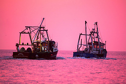 © Licensed to London News Pictures. 15/03/2017. Scarborough UK. Picture shows fishing boats leaving Scarborough harbour this morning as the Met office warns of the arrival of storm Stella on Friday. Photo credit: Andrew McCaren/LNP