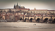 Prague panorama rendered in antique look with Charles Bridge, Kampa quaters, Prague Castle and St. Vitus Cathedral