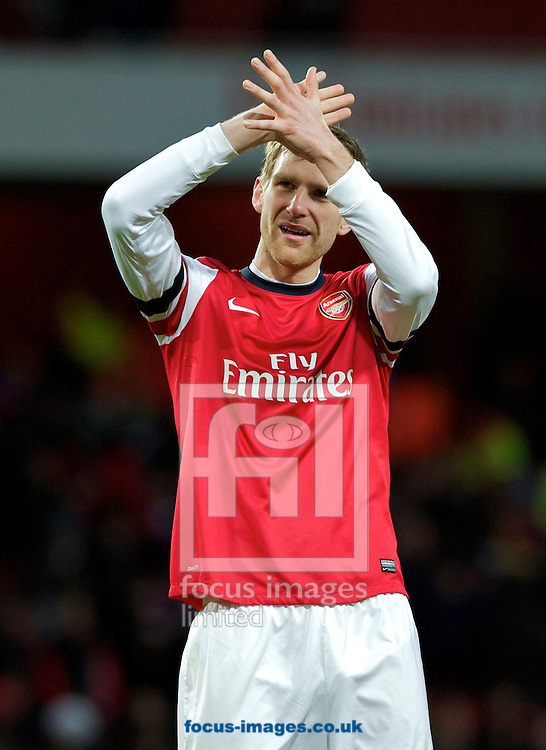 Picture by Alan Stanford/Focus Images Ltd +44 7915 056117.02/02/2013.Per Mertesacker of Arsenal thanks the fans at the end of the Barclays Premier League match at the Emirates Stadium, London.